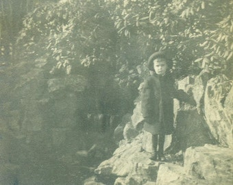 Little Victorian Boy Climbing on Park Rocks Winter Coat Hat Antique Black and White Photo Photograph