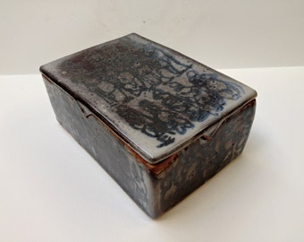 "Carbon Trapped Shino Glazed Lidded Box, with Figures - ""Dark Beginnings"