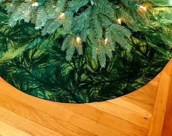 Marimekko Christmas tree skirt with evergreen branch pattern.