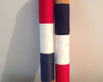 Vintage wood bobbins patriotic red white and blue thread
