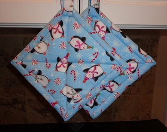 Christmas Penguins on Blue Background Quilted Potholders or Hotpads Set
