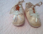 Vintage pink satin baby shoes
