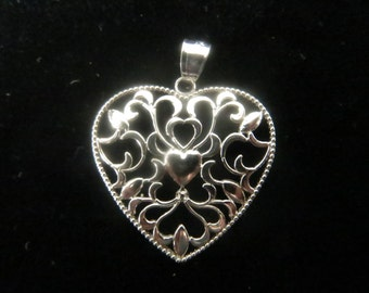 Sterling silver floral design heart pendant