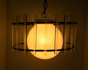 Vintage 1960's Lucite hanging Chandelier -- Clear Lucite Bars in a Circle with black and white accents and white glass globe