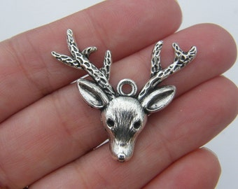 4 Reindeer pendants antique silver tone CT23
