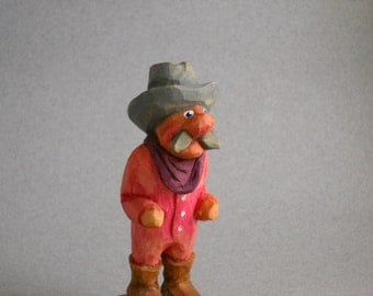 Little cowboy caricature carving.