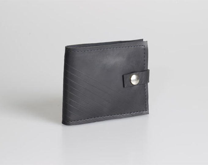 Durable upcycled, innertube wallet. Waterproof black rubber.