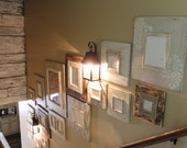 Stairwell Gallery Group of Distressed Frames in Neutrals and Raw Wood