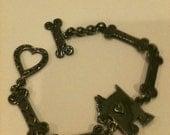 RESERVED FOR LAURA Vintage Scottie Dog and bones sterling silver bracelet.   2a1