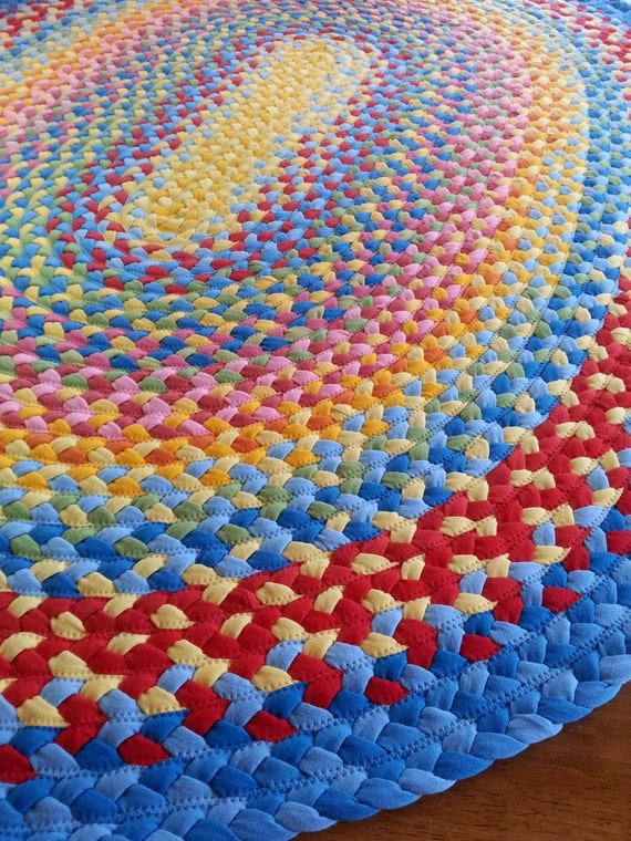"72""x 90"" oval braided rug created from new and recycled t shirts"