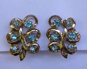 Vintage Gold Toned Screwback Earrings With Light Blue Rhinestones Signed Coro