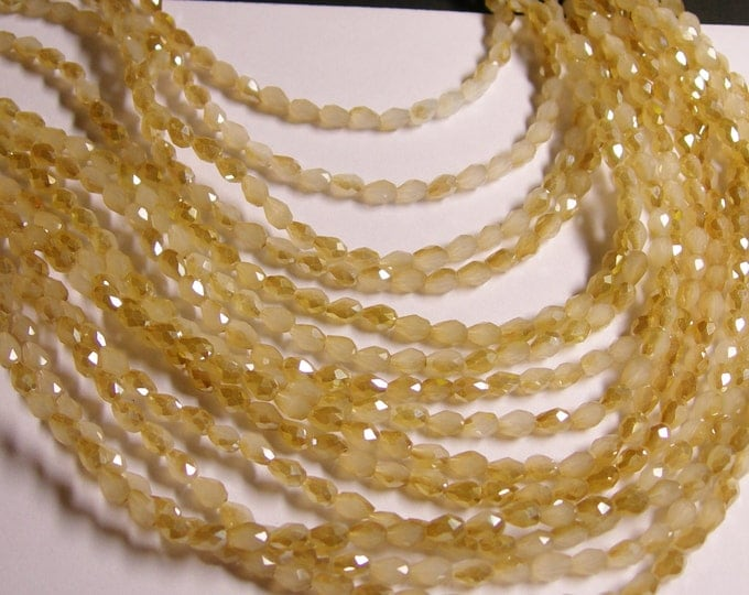Faceted teardrop crystal beads - 100 pcs - 3mm x 5mm -  ab finish - beige - CLGD27