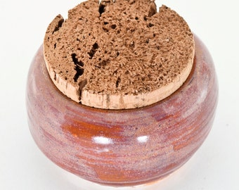 pink and purple variegated jar with cork lid