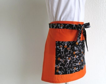 Childrens Half Apron SALE-Halloween Silly Skeletons on Solid Orange Kids Half Apron, Fun to cook, bake and hold all your goodies in