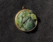 Emerald City pendant: peridot, apatite, green garnet, aquamarine, brass bezel