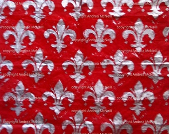 Sheet of red tissue paper, handprinted with silver Fleur-de-lys lino print