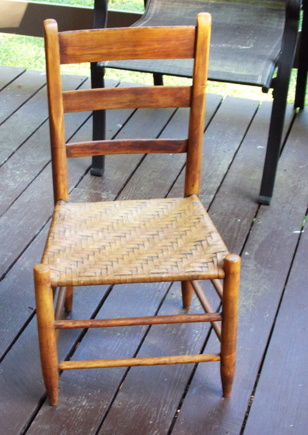 antique straight back wood chair has a cane seat with a by daiya