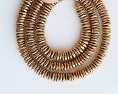 6mm Gold plated brass  faceted, flat spacer beads.