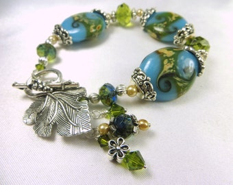 Lampwork Glass Bracelet in Seascape Teal and Olive Green with silver leaf toggle clasp with charms