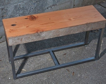 Recycled wood beam top with geometric metal base