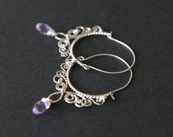 Sterling silver filigree earrings with violet glass beads