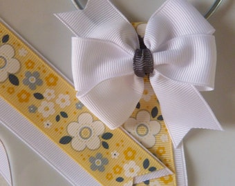 yellow and gray flowered print bow holder