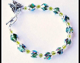 Rainbow Green Crystal And Yellow Beaded Butterfly Charm Bracelet With Matching Earrings