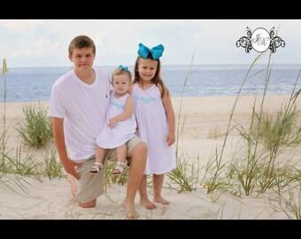 Monogrammed white sleeveless beach picture dress