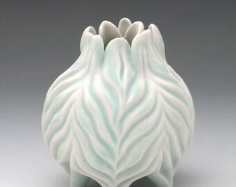 Carved porcelain aqua blue and white squat vase