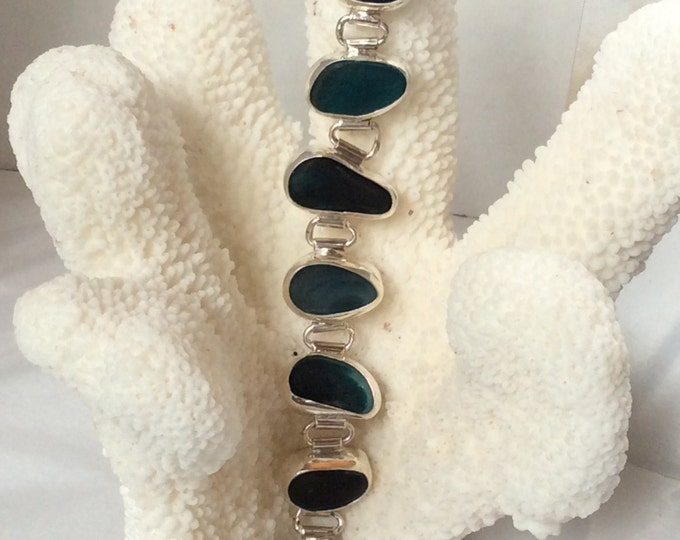 Sterling silver bezel set Seaham beach multi colored peacock blue/green hinged bracelet