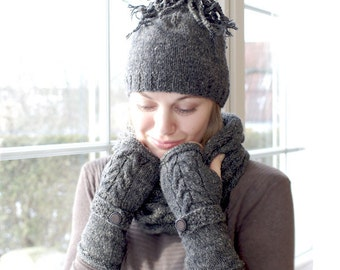 Hand knitted gray silk and wool melange hat with a cheerful pompon