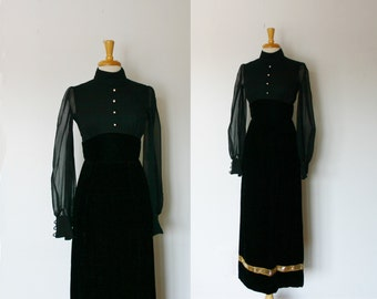 1960s femme fatale black evening gown with sheer sleeves, size medium