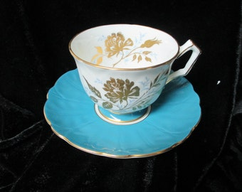 Aynsley  Turquoise and Gold Roses and Rose Buds Cup and Saucer