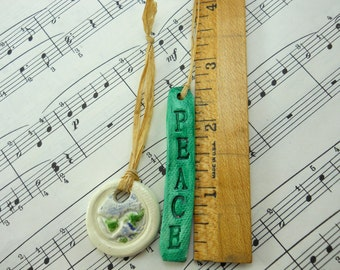 PEACE ON EARTH pair of ceramic ornaments, one globe and one green stamped word, hand made of clay, year round decor