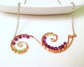 Handmade double swirl copper necklace wire wrapped with amethyst and peridot on sterling silver chain