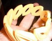 carved cut out tears ovals yellow bakelite bangle bracelet vintage