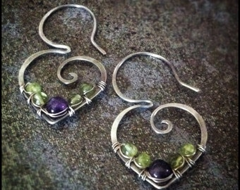 Amethyst and peridot wire wrapped onto sterling silver ear wires. Handmade earrings by Gypsy Lotus