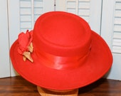 Gorgeous Red hat with Rose on the Left side