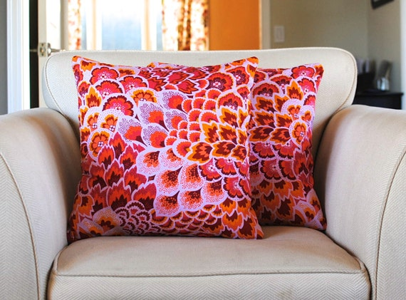 Vibrant pink and orange decorative pillow by kangaroostitches