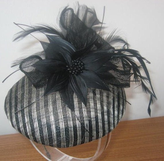 Black and white handmade cocktail hat with feather flower and biot feathers
