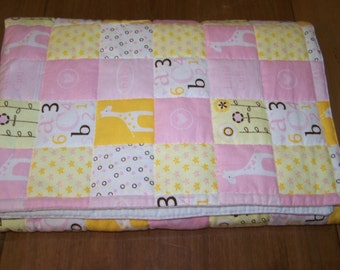 Yellow and Pink Hand Quilted Flannel Blanket