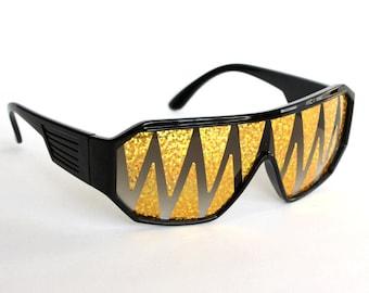 Rasslor Holographic Gold Shark Teeth Black Shield Sunglasses