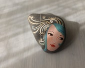 Painted stone. cute painting on stone. Beach pebbles art