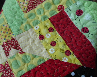 Ladybug childrens nursery quilt sunny yellow red green strippy quilt