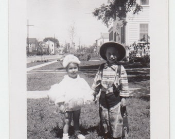 Vintage/Antique  photo of a  little boy and a girl wearing costumes