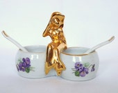 Paris Porcelain salts or mustard pots, with violets and a gold lady