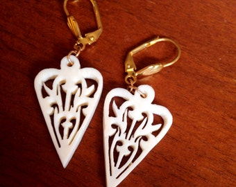 Vintage white carved earrings
