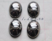 Four Vintage 13mm X 18mm Hematite Cabochons