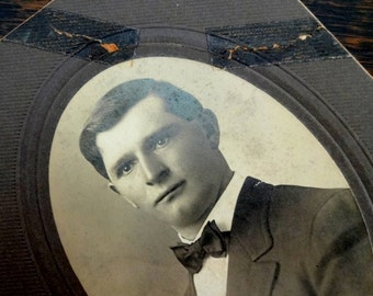 Early 1900s Photograph of Young Man in Suit and Bow Tie