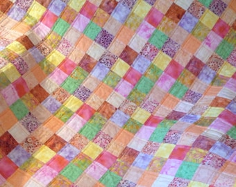 "Batiks and The Colors of Rainbow Sherbet Blend Brightly In This 39"" X 39"" Postage Stamp Quilt"